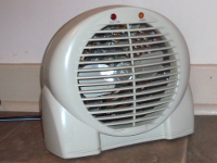 Space heater sitting on floor near wall
