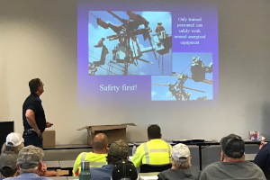 Co-op employee explains dangers of working around power lines to highway workers