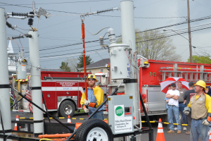 Co-op lineworkers present hot line demo to volunteer firefighters