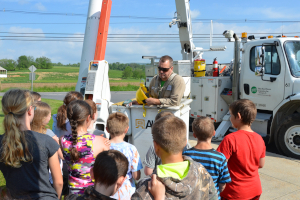 Co-op lineworker demonstrates bucket truck
