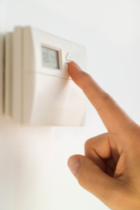Hand adjusting thermostat setting